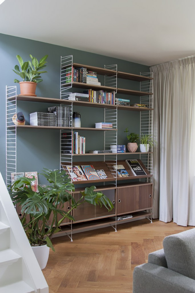 Corner of the livingroom with String bookcase
